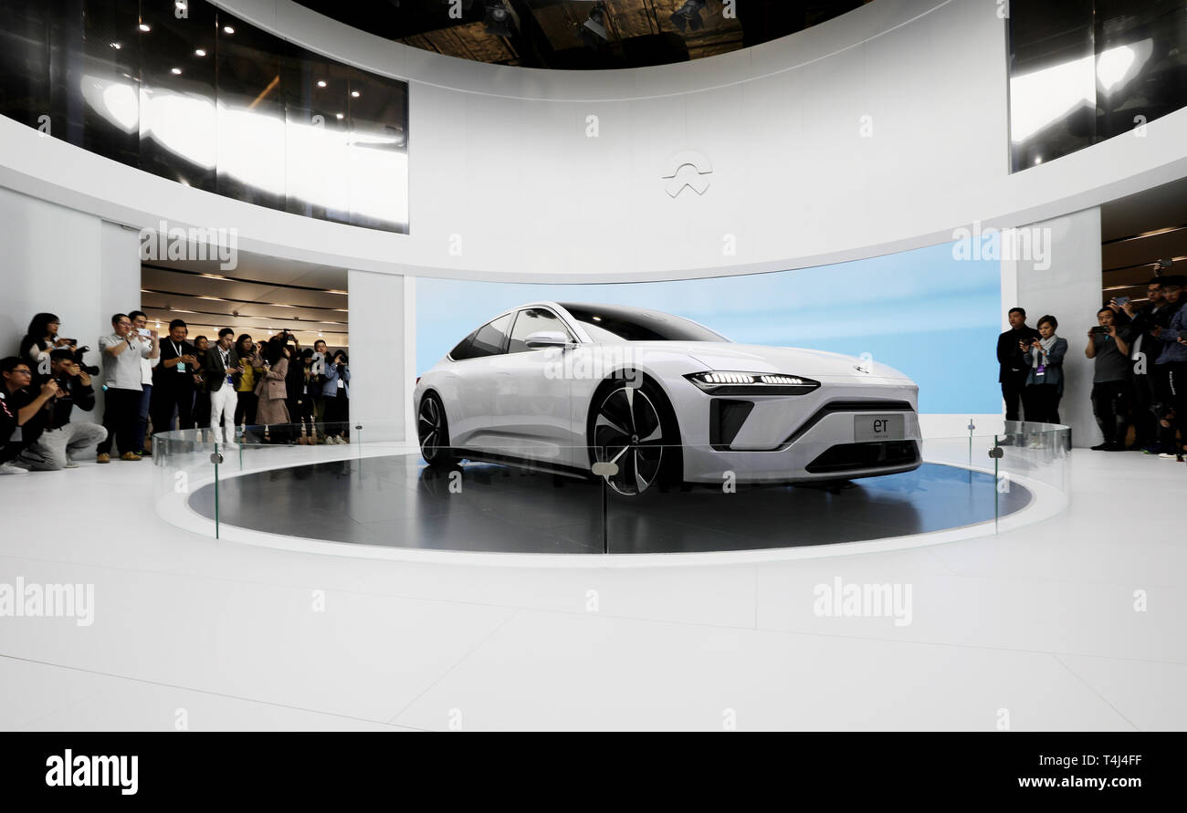 Shanghai, China. 16th Apr, 2019. Visitors view a Nio eT Preview car during the 18th Shanghai International Automobile Industry Exhibition in Shanghai, east China, April 16, 2019. Credit: Fang Zhe/Xinhua/Alamy Live News Stock Photo