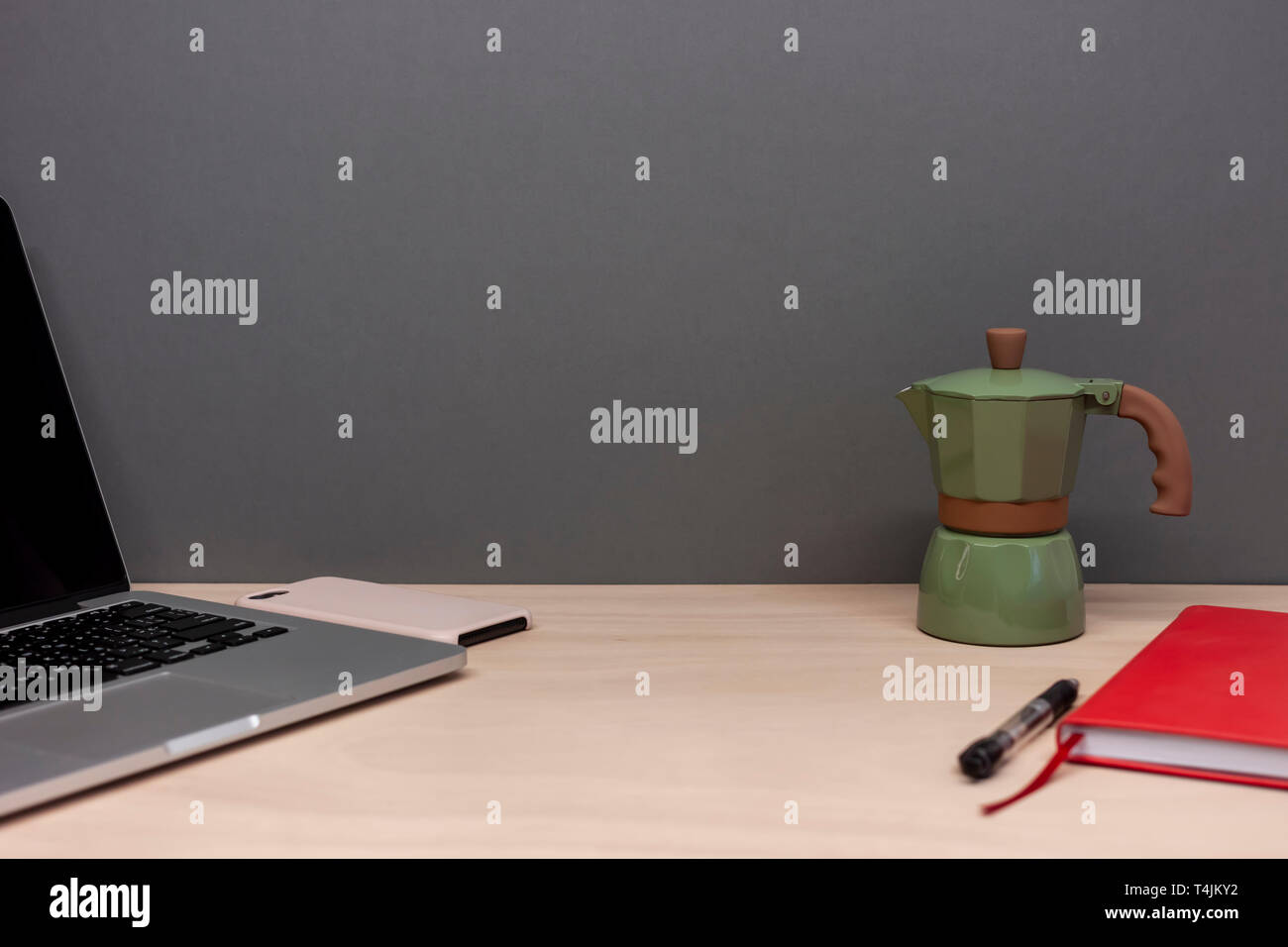 working table with laptop notebook and italian coffee maker - Stock Image