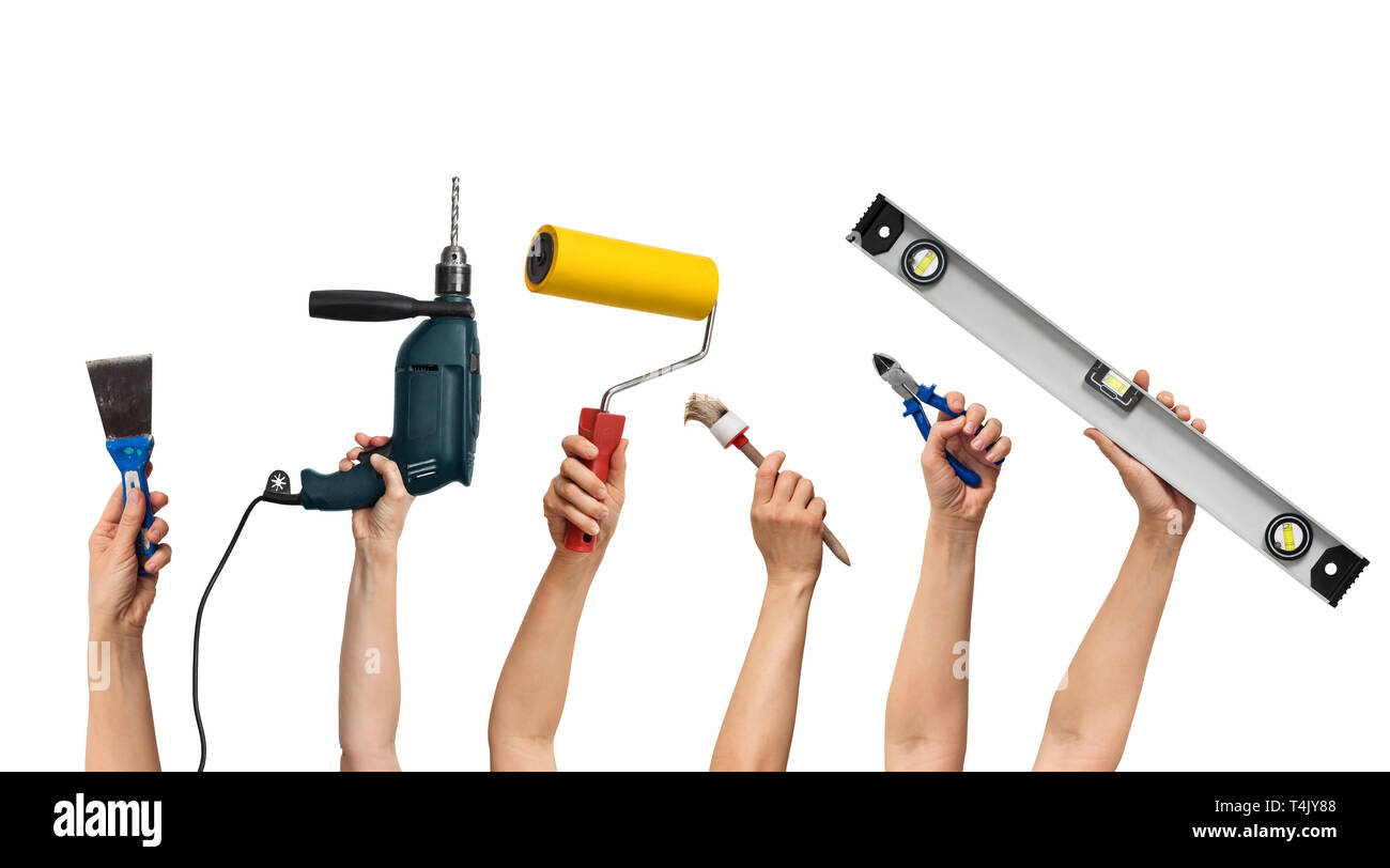 tool set for home repair in hands, on white background - Stock Image