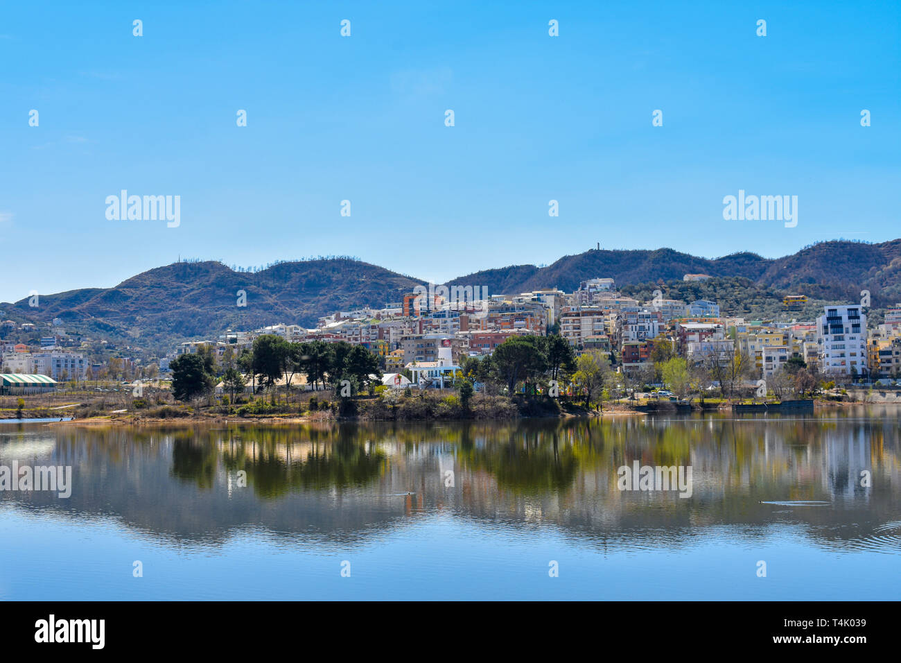 city scape reflecting on the artificial lake of tirana - Stock Image