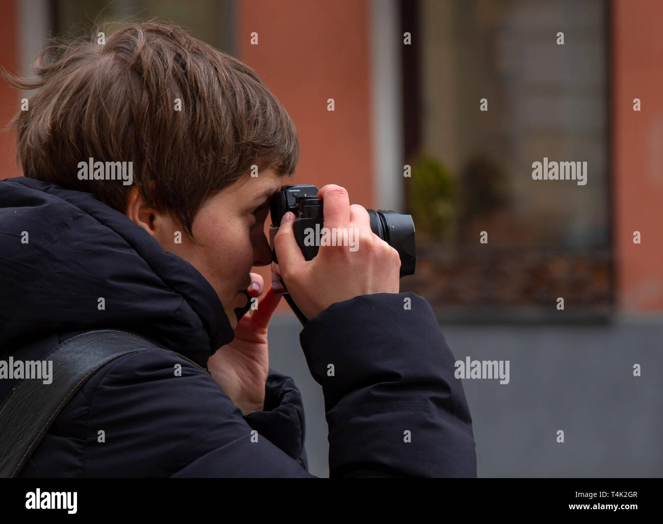 April 2019, Moscow, Russia.Girl photographer in profile.Photographs the streets of Moscow - Stock Image