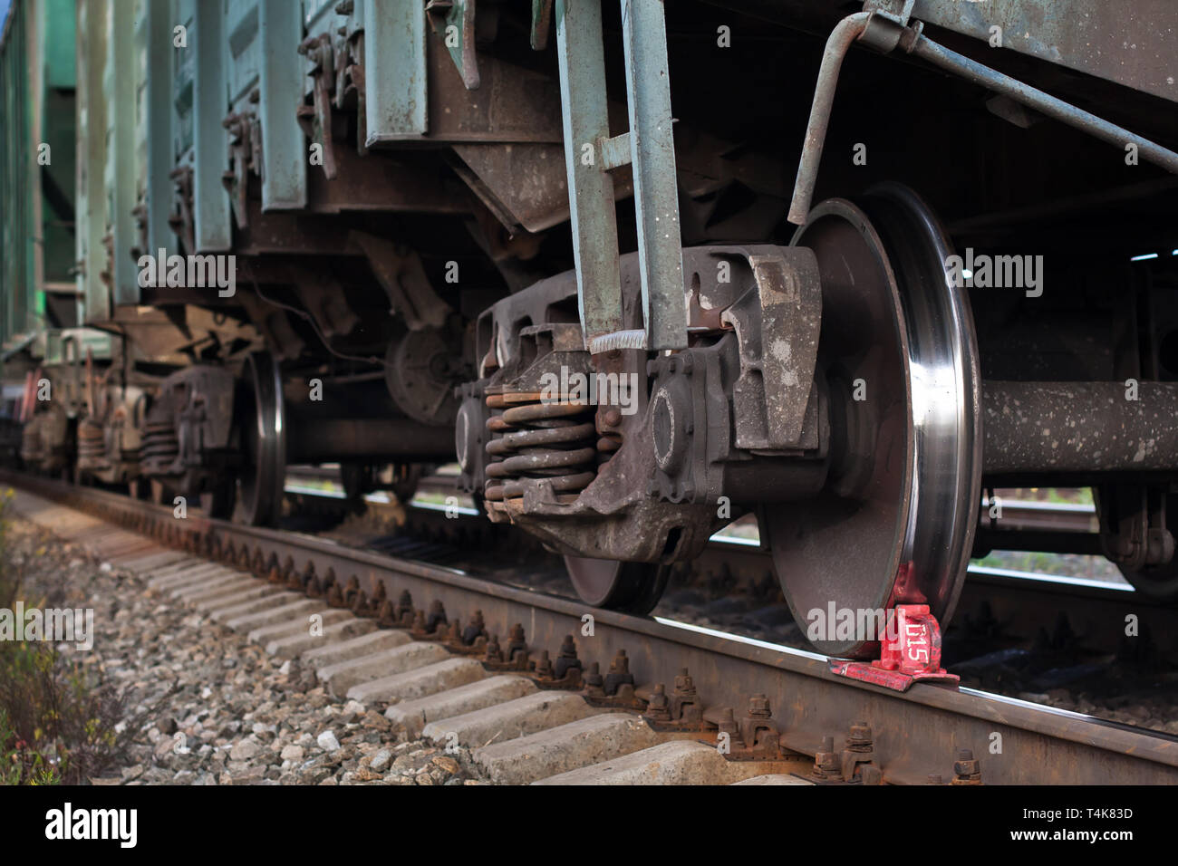 red railway brake Shoe stops the train on the rails - Stock Image