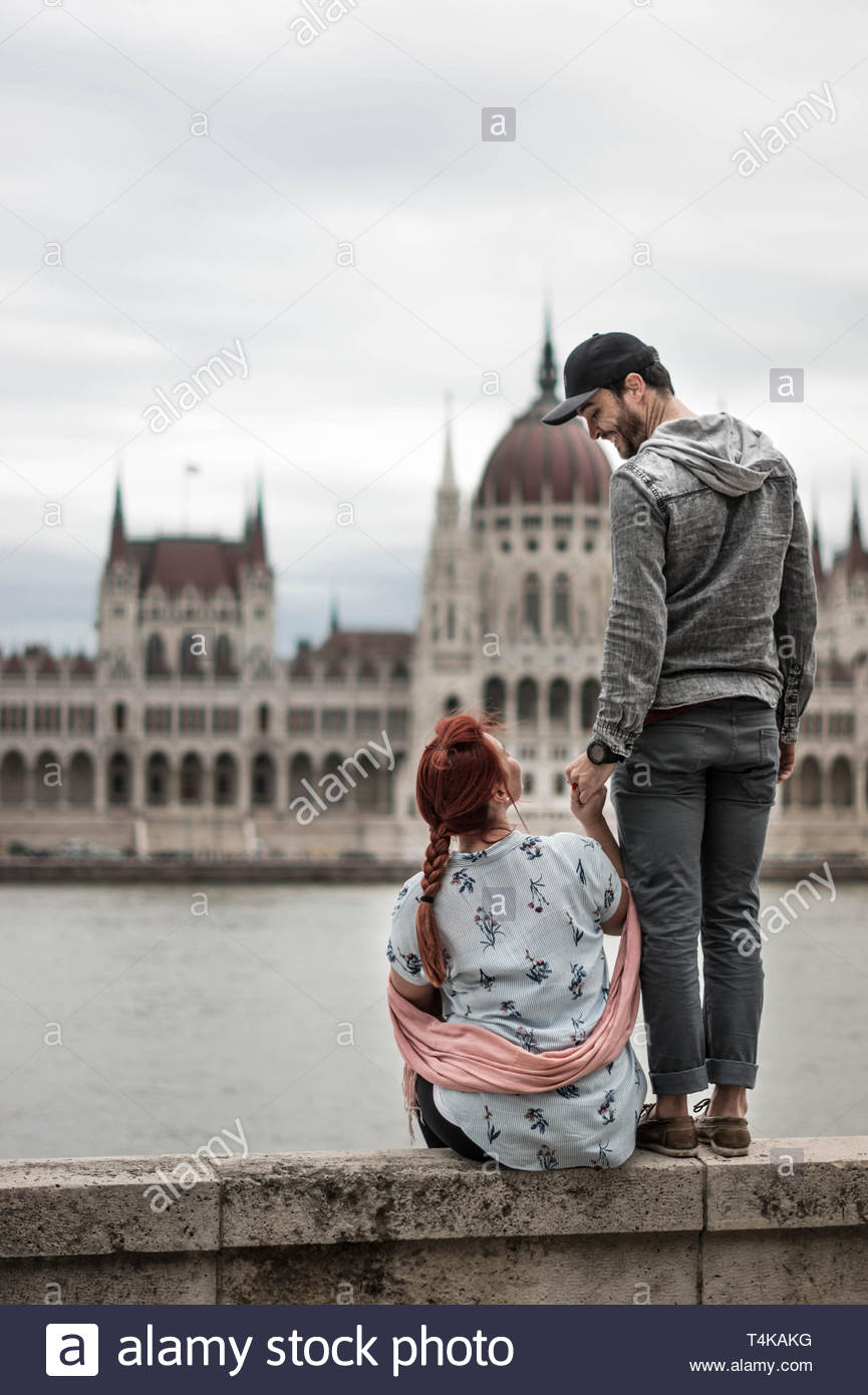 man holding woman's hand Stock Photo