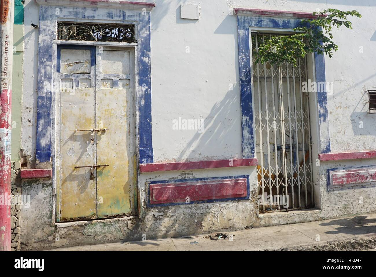 Close Up of a Caribbean Building that has seen Better Days - Stock Image