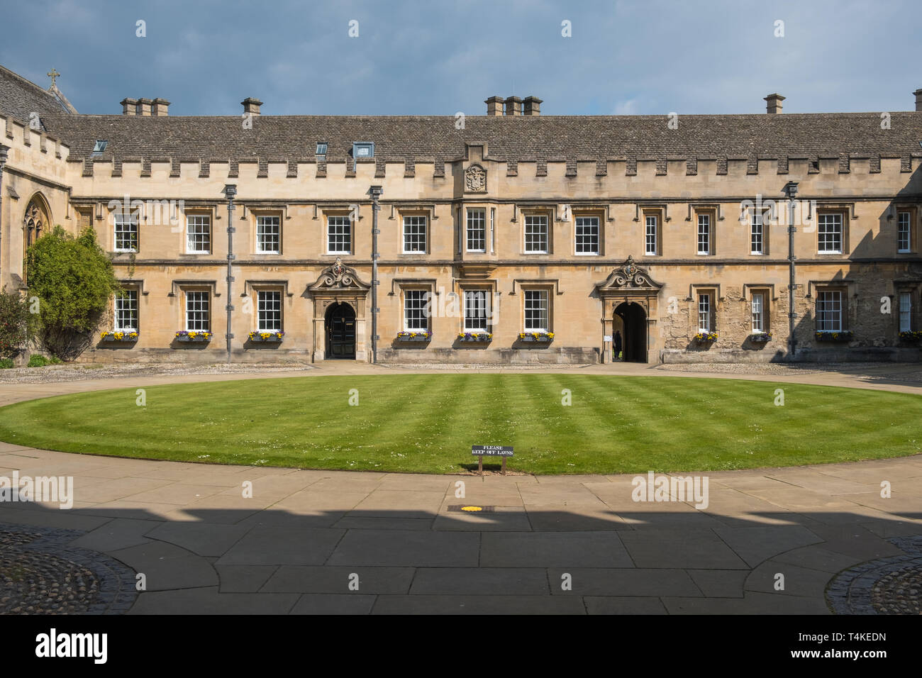 Neat circular lawn at St John's College, Oxford, UK - Stock Image