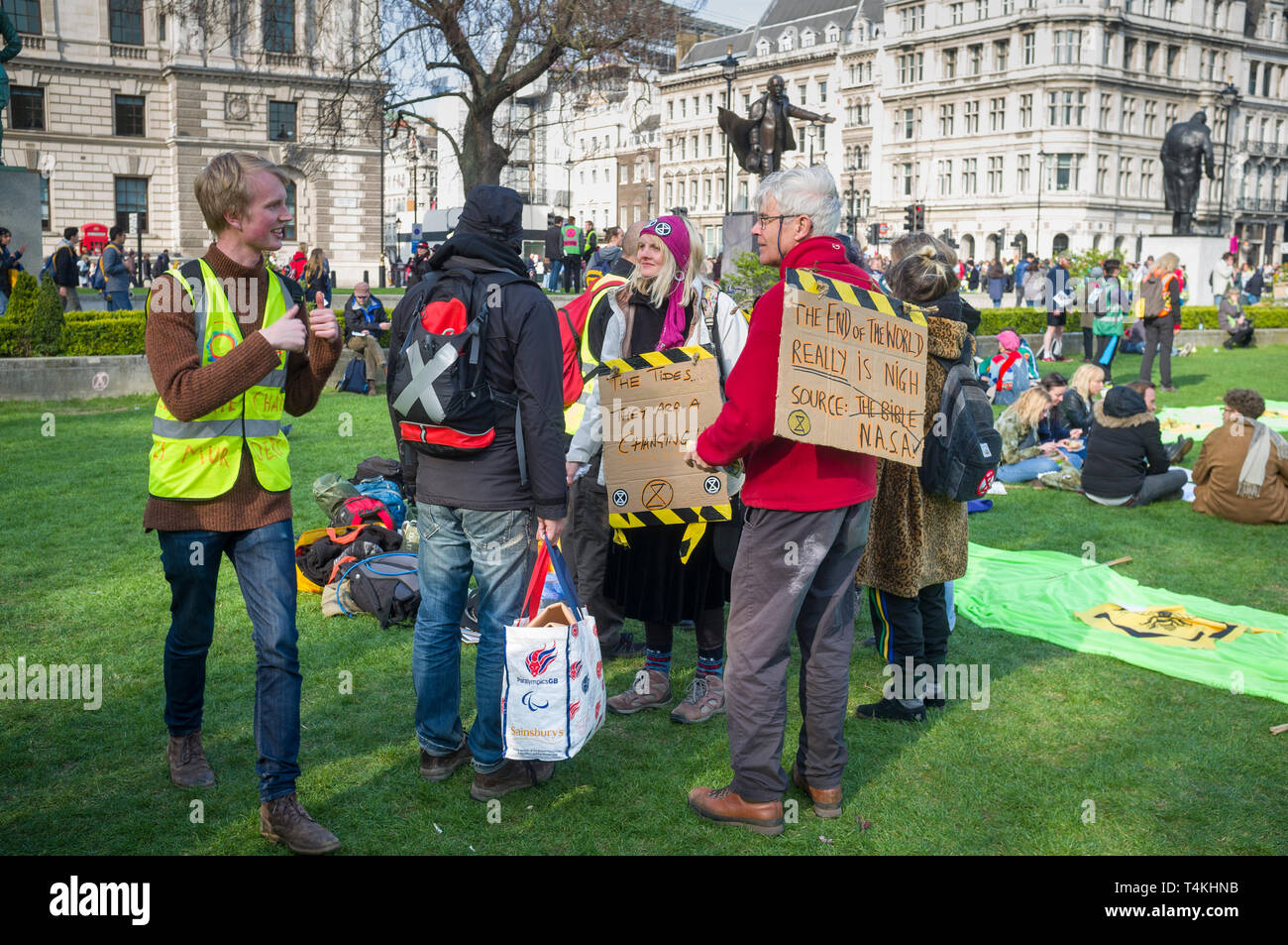 Demonstrators with banners congregate on Parliament Green, Westminster for the Extinction Rebellion demonstration Stock Photo