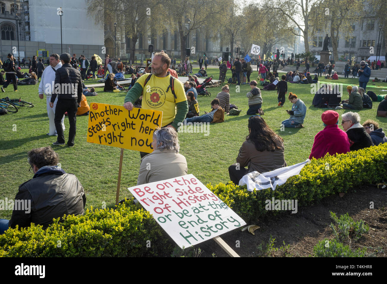 Protestors from Extinction Rebellion with banners congregate on Parliament Square, Westminster for the Extinction Rebellion demonstration - Stock Image