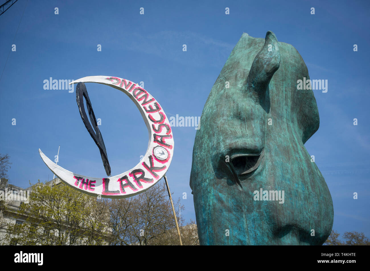 A crescent shaped banner entitled 'The Lark Ascending' at the Extinction Rebellion demonstration in Marble Arch against a detail of the Marwari Horse  - Stock Image