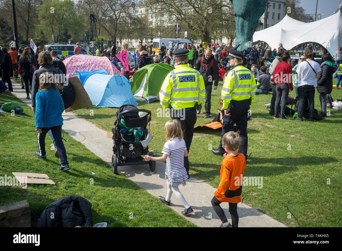 Two policemen from the Metropolitan Police walk through the encampment at the Extinction Rebellion demonstration at Marble Arch - Stock Image