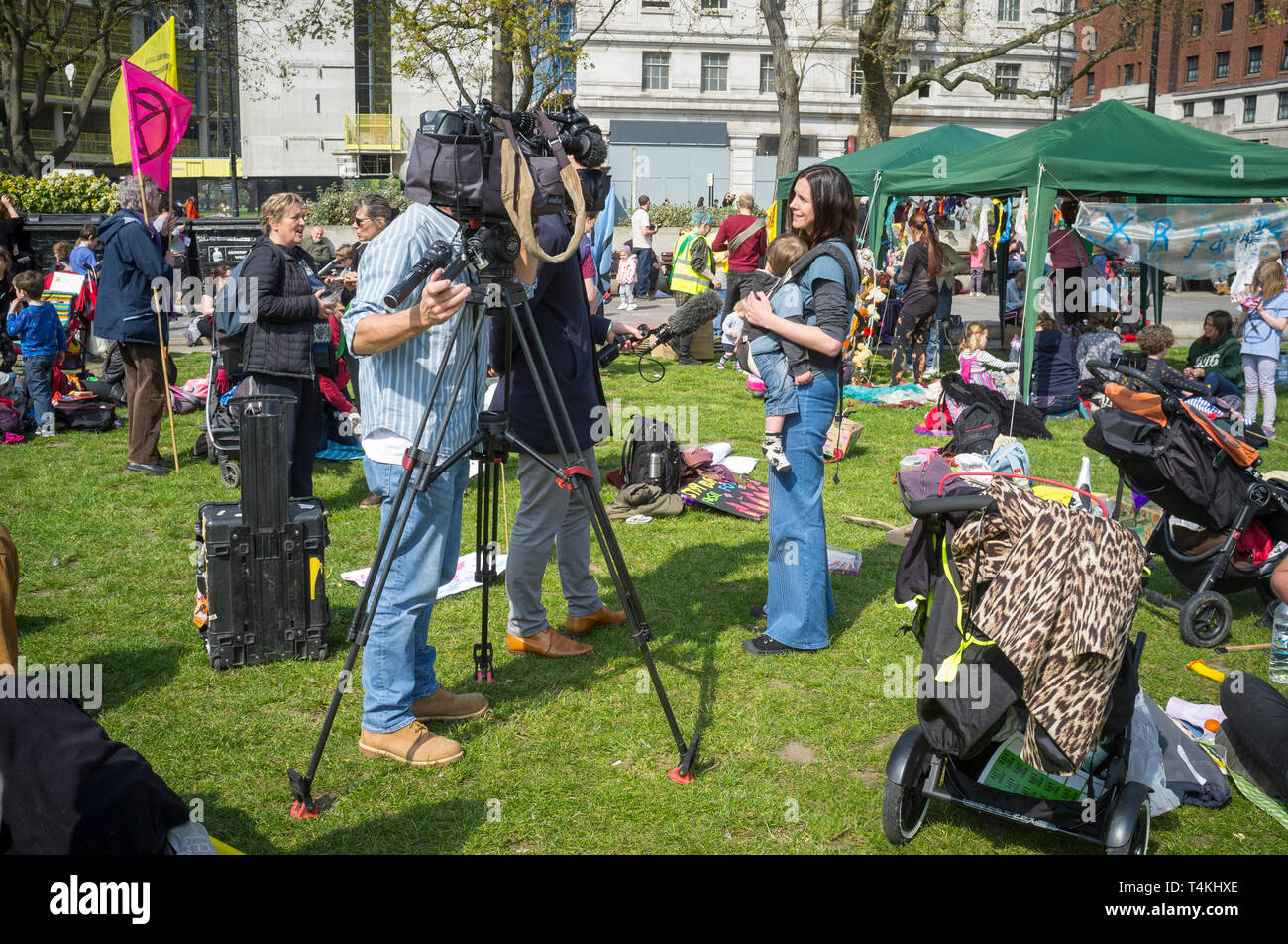 A TV media crew film an interview at the Extinction Rebellion demonstration in Marble Arch - Stock Image