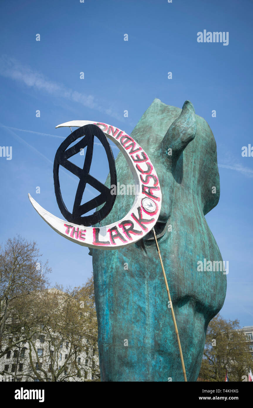 A crescent shaped banner entitled 'The Lark Ascending' at the Extinction Rebellion demonstration in Marble Arch against a detail of the Marwari Horse  Stock Photo