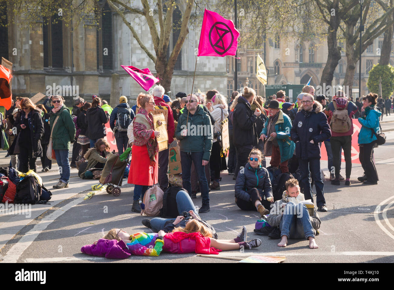 Demonstrators sit in the road blocking Victoria Street by Parliament Square, Westminster for the Extinction Rebellion demonstration Stock Photo
