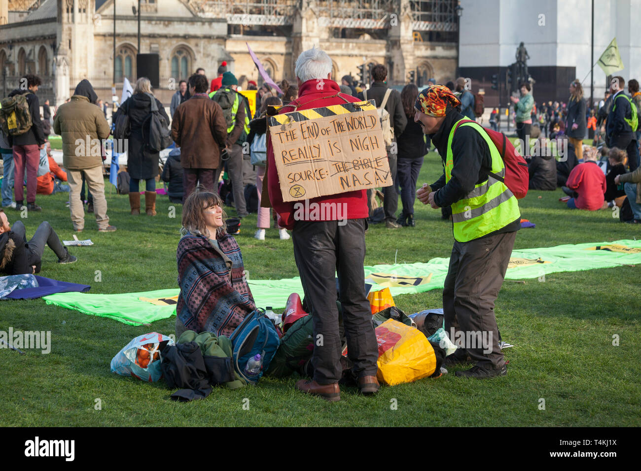 Protestors with banners congregate on Parliament Square, Westminster for the Extinction Rebellion demonstration - Stock Image