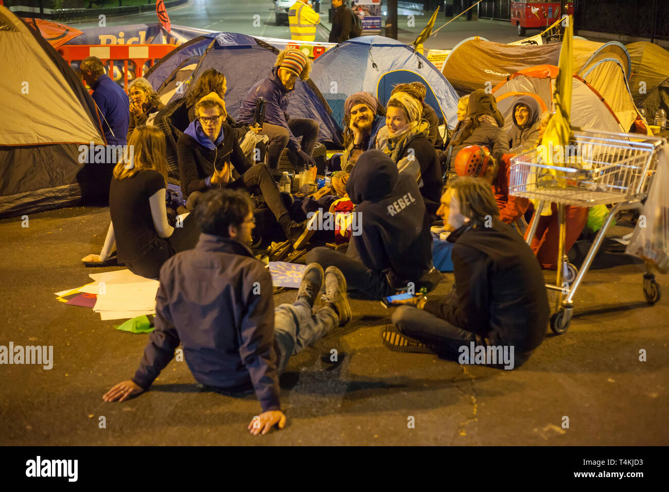 A group of students sit on the road at night at Marble Arch for the Extinction Rebellion demonstration Stock Photo