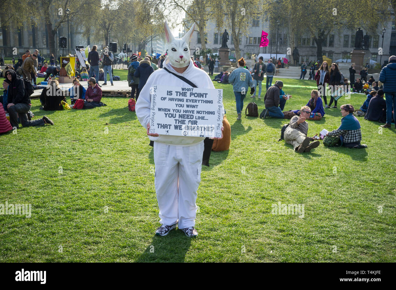A protestor dressed as a White Rabbit on Parliament Green, Westminster for the Extinction Rebellion demonstration Stock Photo
