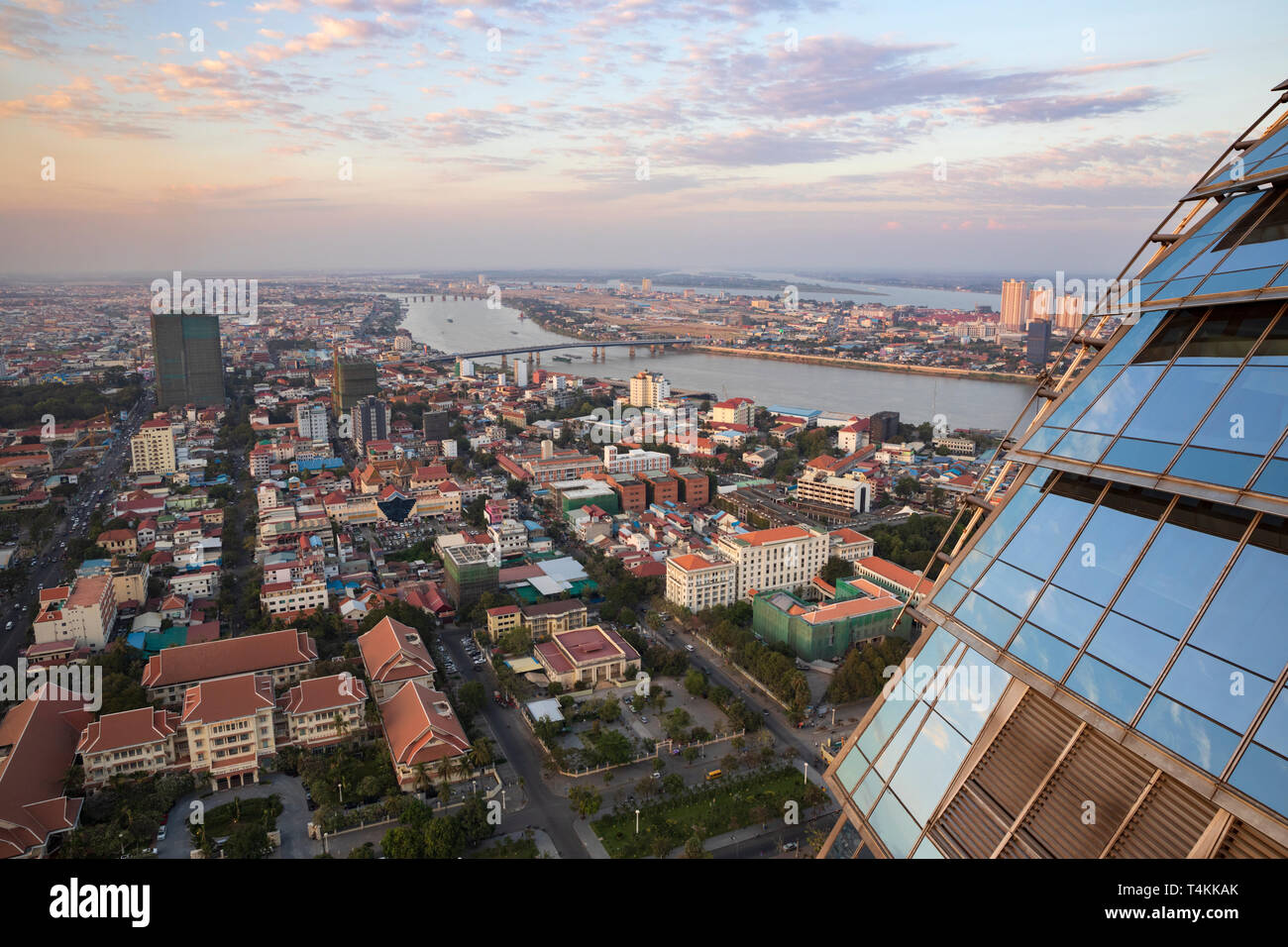View over city at sunset from the Sky Bar at the Rosewood Phnom Penh, Phnom Penh, Cambodia, Southeast Asia, Asia - Stock Image