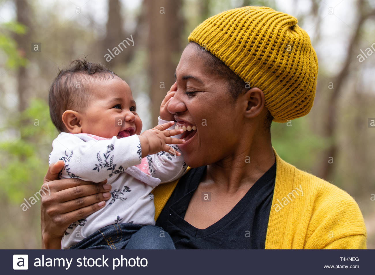 African-American mother and daughter in a forest - Stock Image