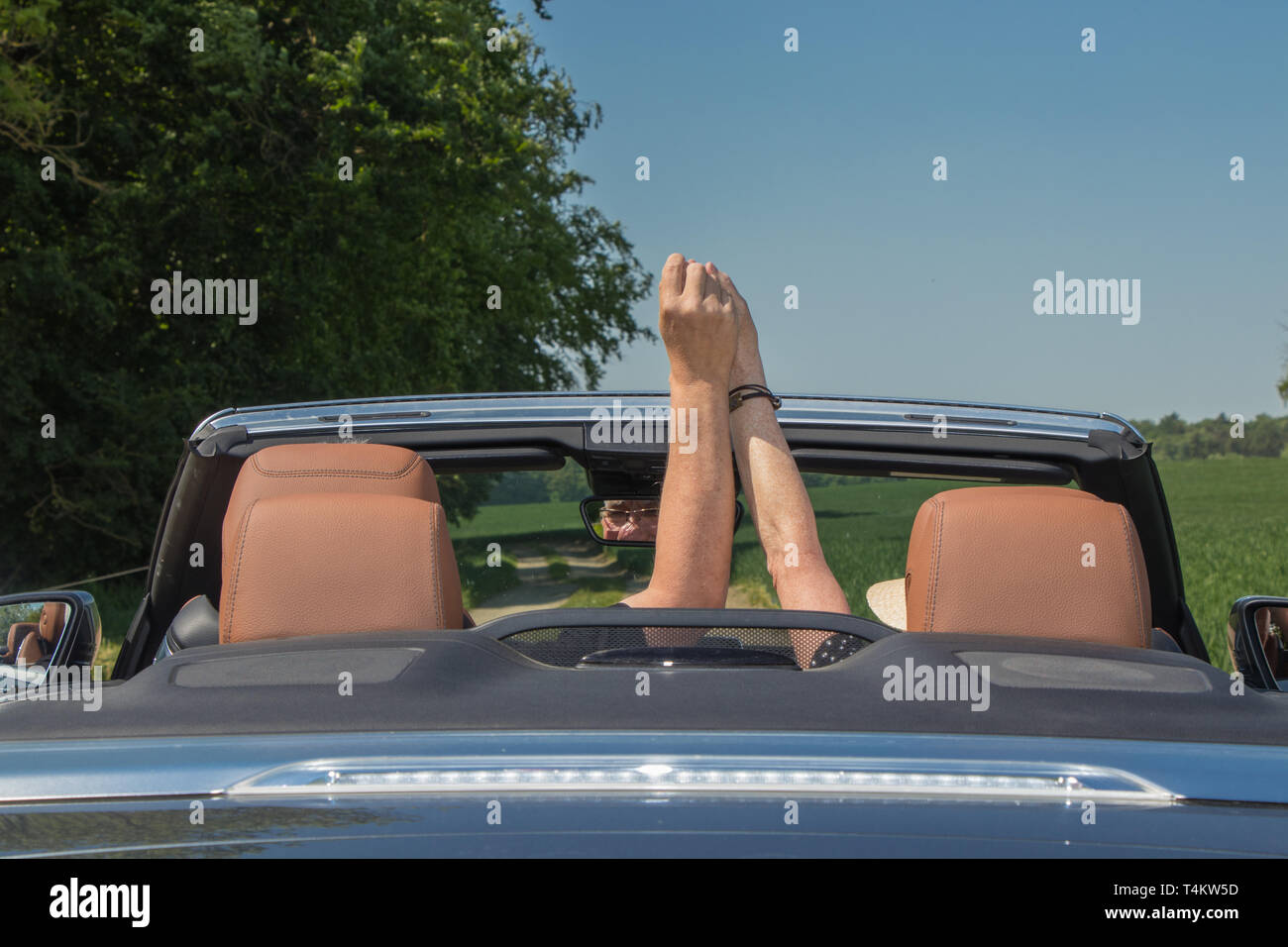 Senior couple with a luxury convertible car - Stock Image