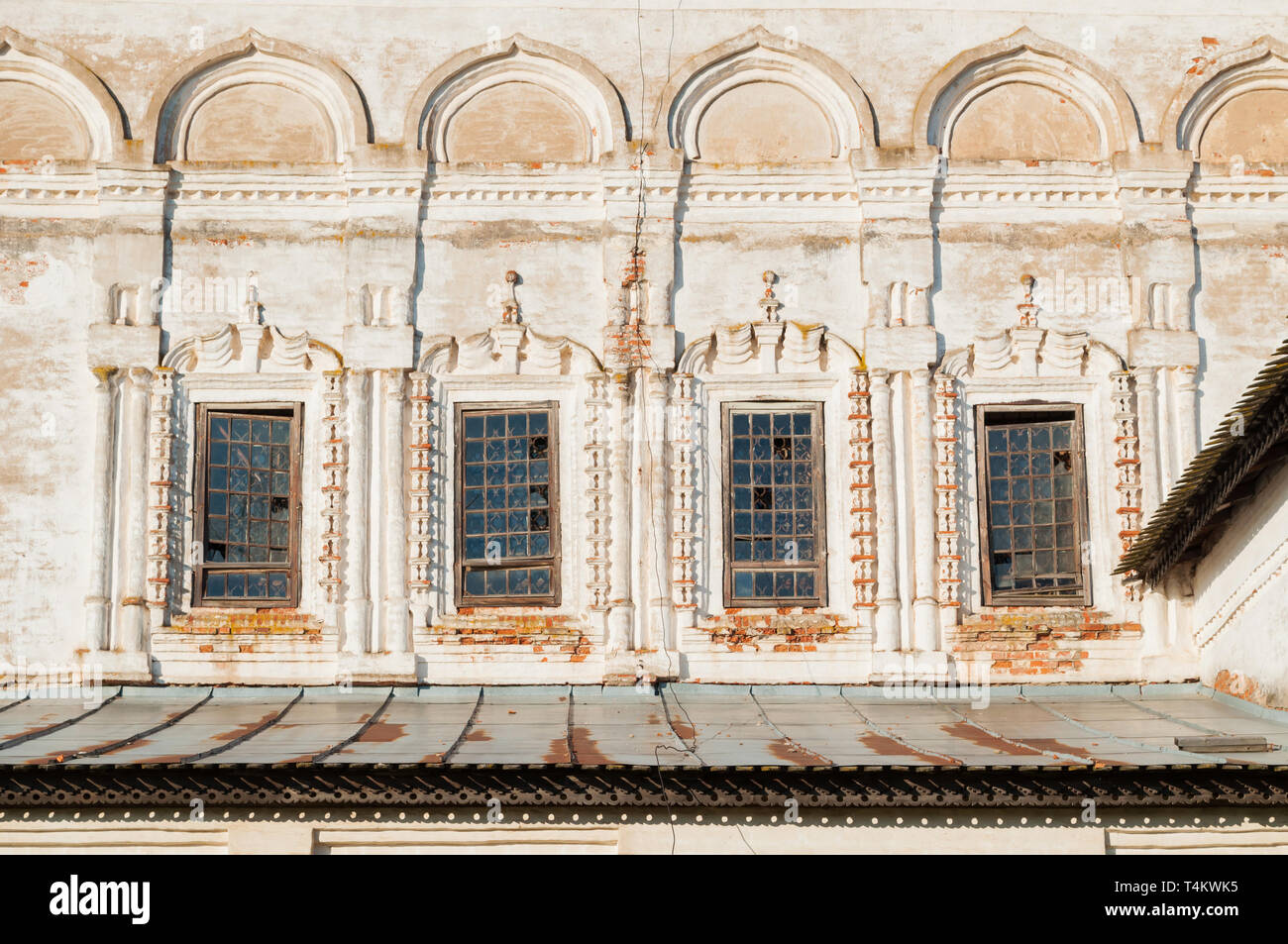 Veliky Novgorod, Russia. Windows with arches and stucco at the facade of Resurrection Cathedral of Derevyanitsky monastery in Veliky Novgorod surround Stock Photo