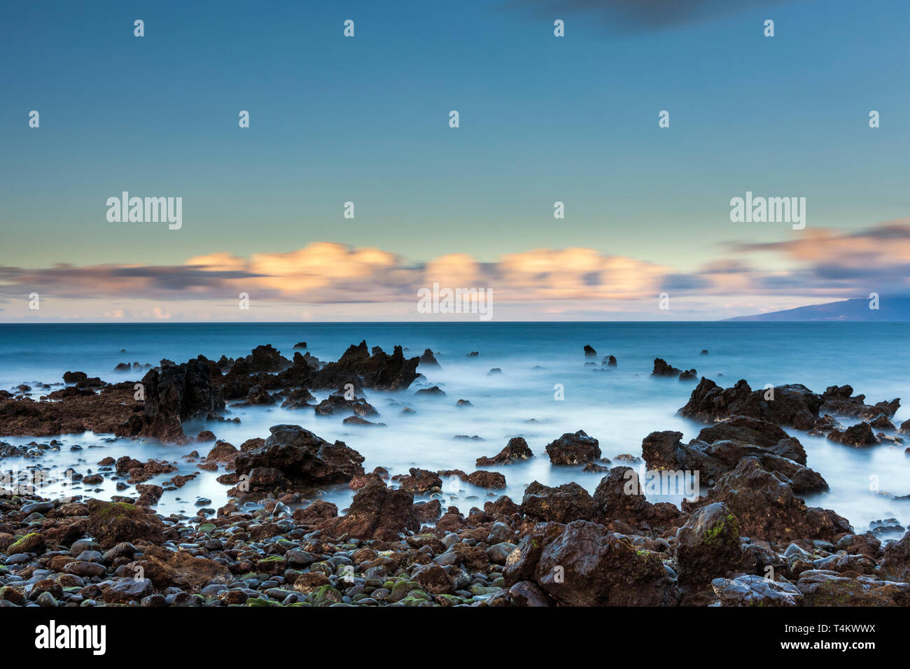 Seascape coastline of west Tenerife at dawn made using long exposure photography with nuetral density filters to create silky water and movement in th Stock Photo
