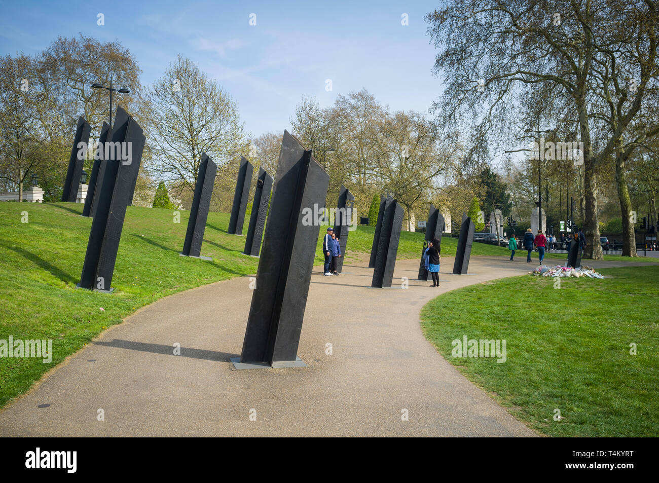 Tourists take photographs by the New Zealand War Memorial in Hyde Park Gate, London - Stock Image