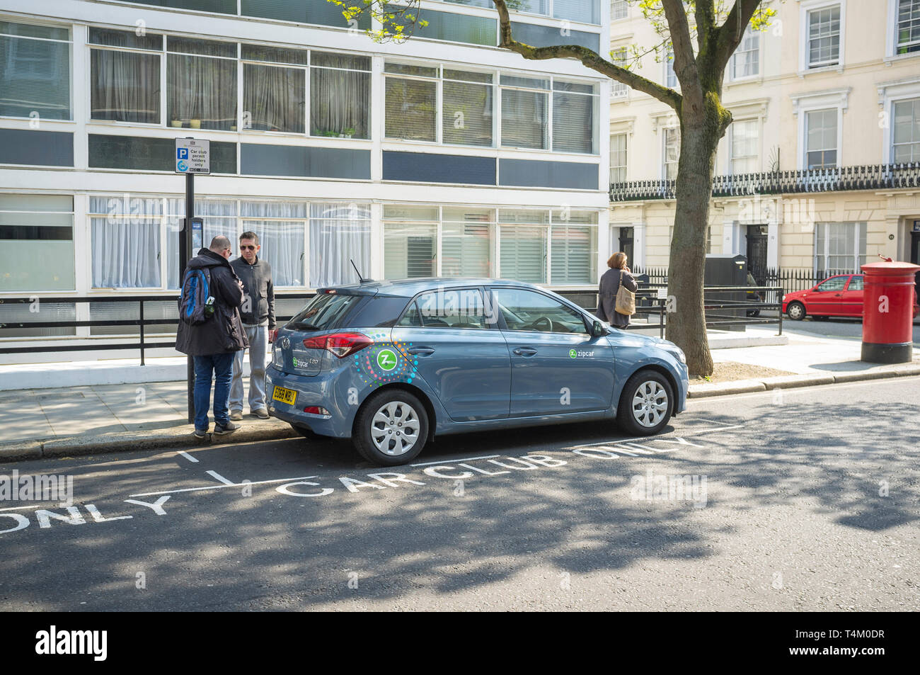 A Zipcar car-sharing car parked in a Car Club Only parking bay in Paddington, London - Stock Image