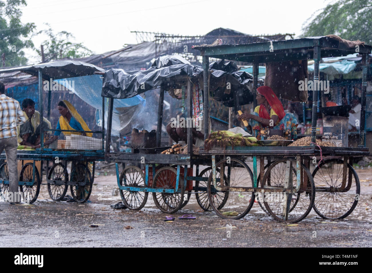 Street food market carts under a heavy rain in Rajasthan, India - Stock Image