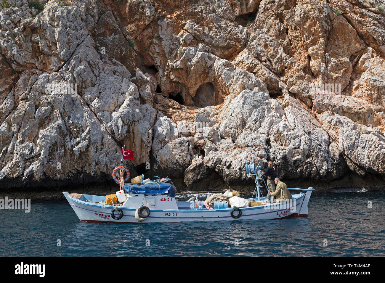 fishing boat in front of the entrance to the love cave, Alanya, Province Antalya, Turkey - Stock Image