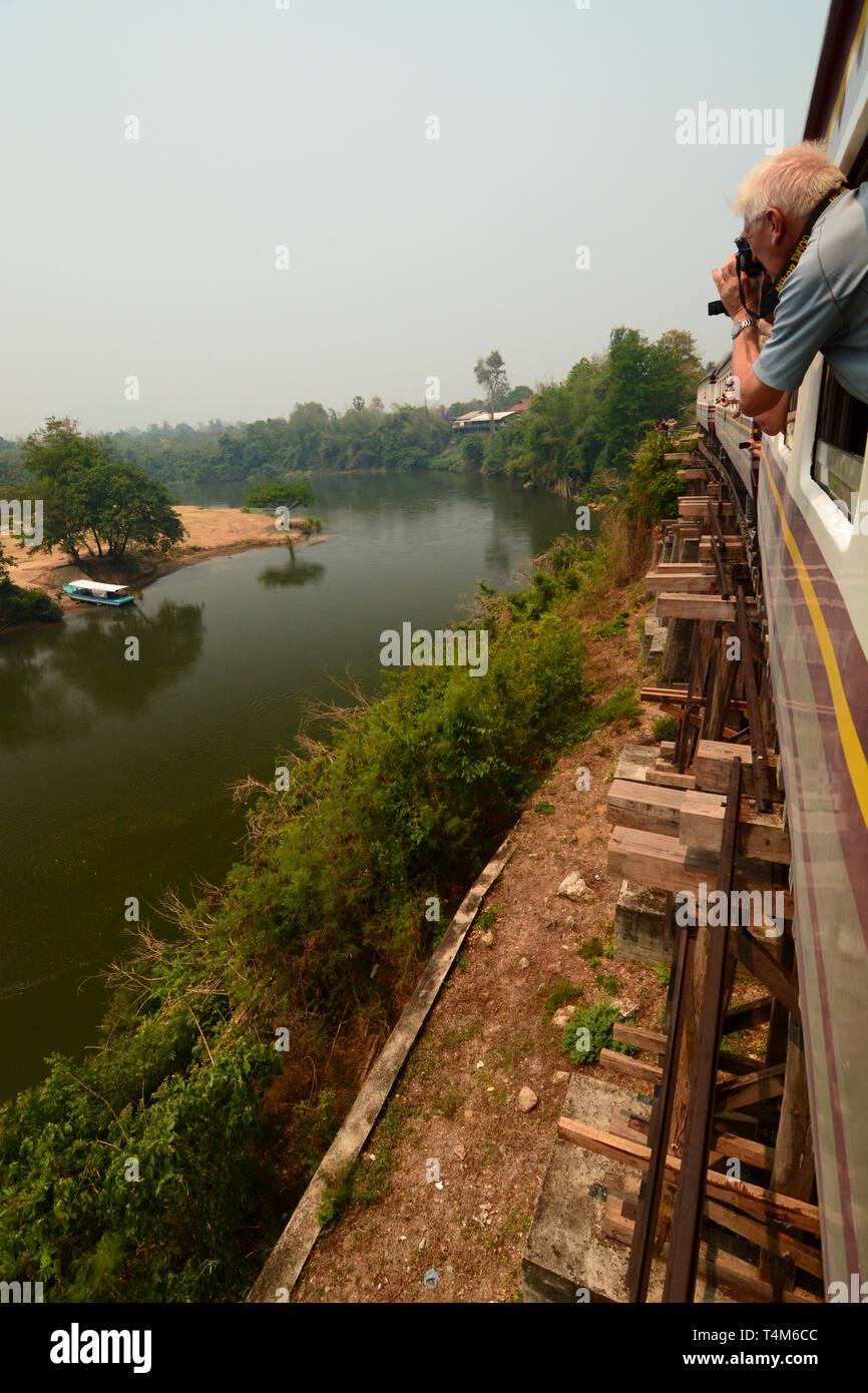 Travelling on the Wampo viaduct. Historic thai-burma railway. Kanchanaburi province. Thailand - Stock Image