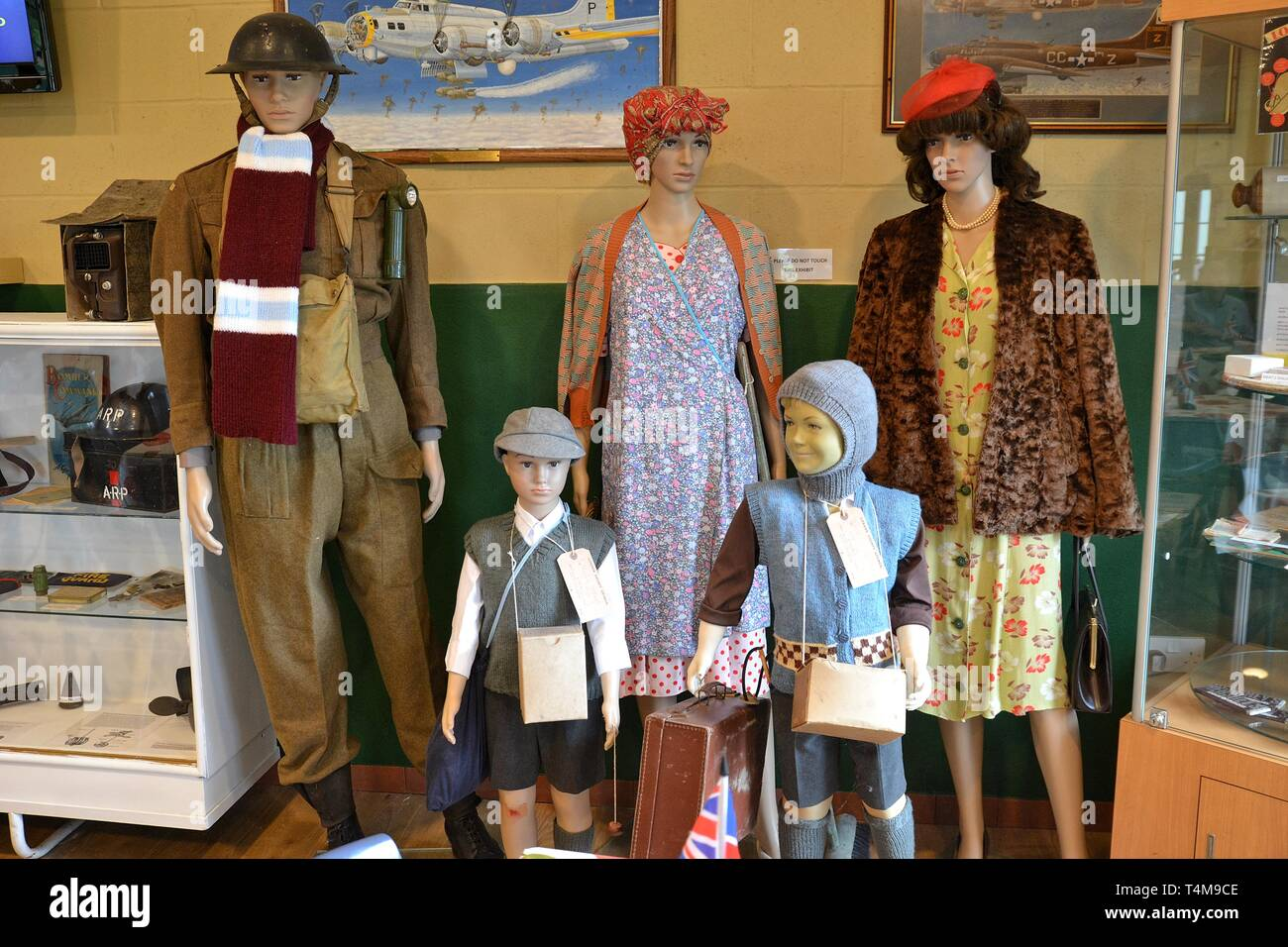 1940s family with evacuees in the Home Front Exhibition at the Parham Airfield Museum, Framlingham, Suffolk, England, UK - Stock Image