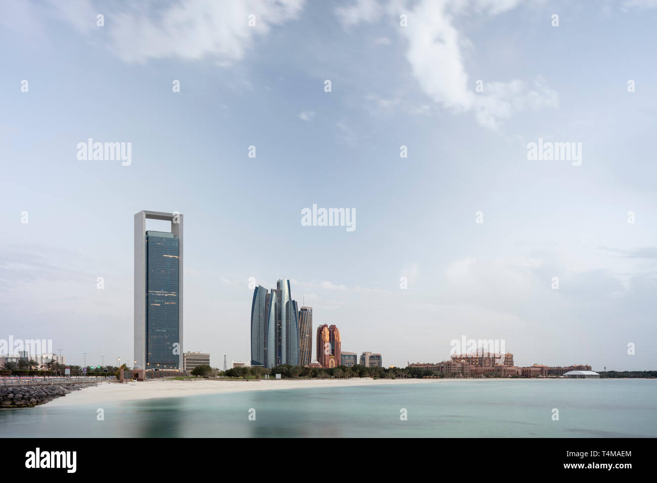 ABU DHABI, UNITED ARAB EMIRATES - April 5, 2019: Abu Dhabi National Oil Company / ADNOC head office (left), Etihad Towers (centre), which consist of r - Stock Image