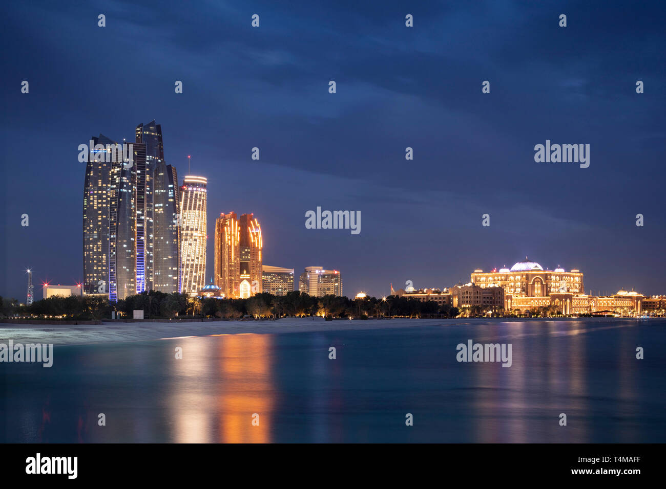 ABU DHABI, UNITED ARAB EMIRATES - April 5, 2019: Etihad Towers (left), which consist of residential apartments and a Jumeirah hotel, and Emirates Pala - Stock Image