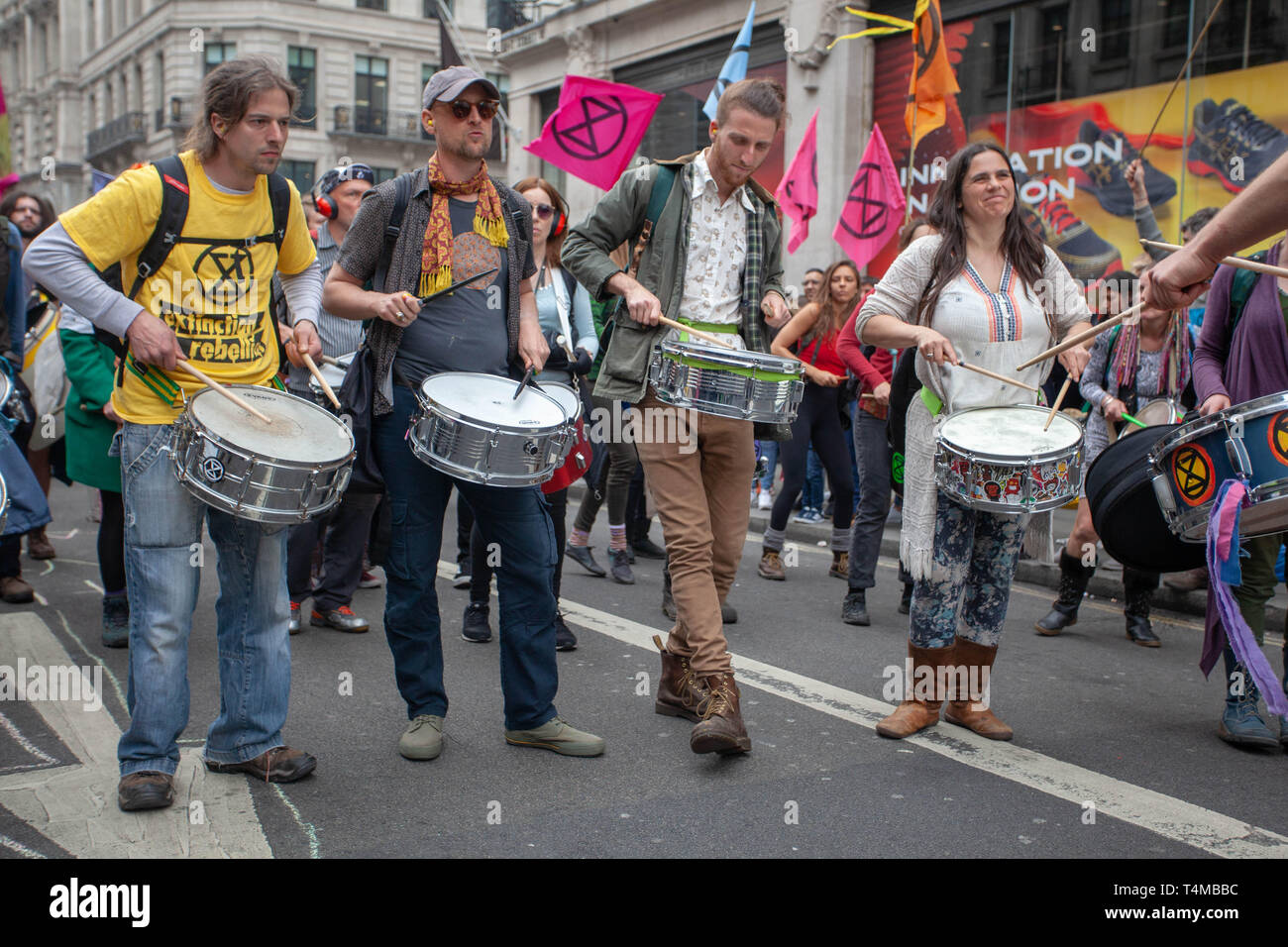 17th April 2019: Extinction Rebellion: Climate change activists playing drums along Regent Street, Oxford Circus, London, UK Stock Photo