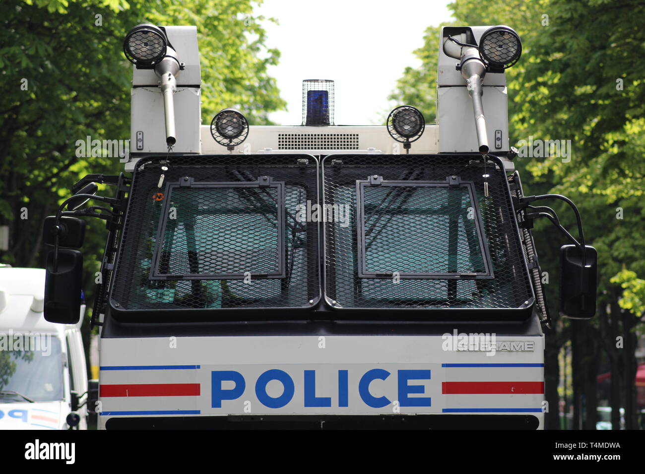 A Police Nationale water cannon sits idle waiting to be used at the Yellow Vest Protests in Paris on the 13th April 2019. - Stock Image