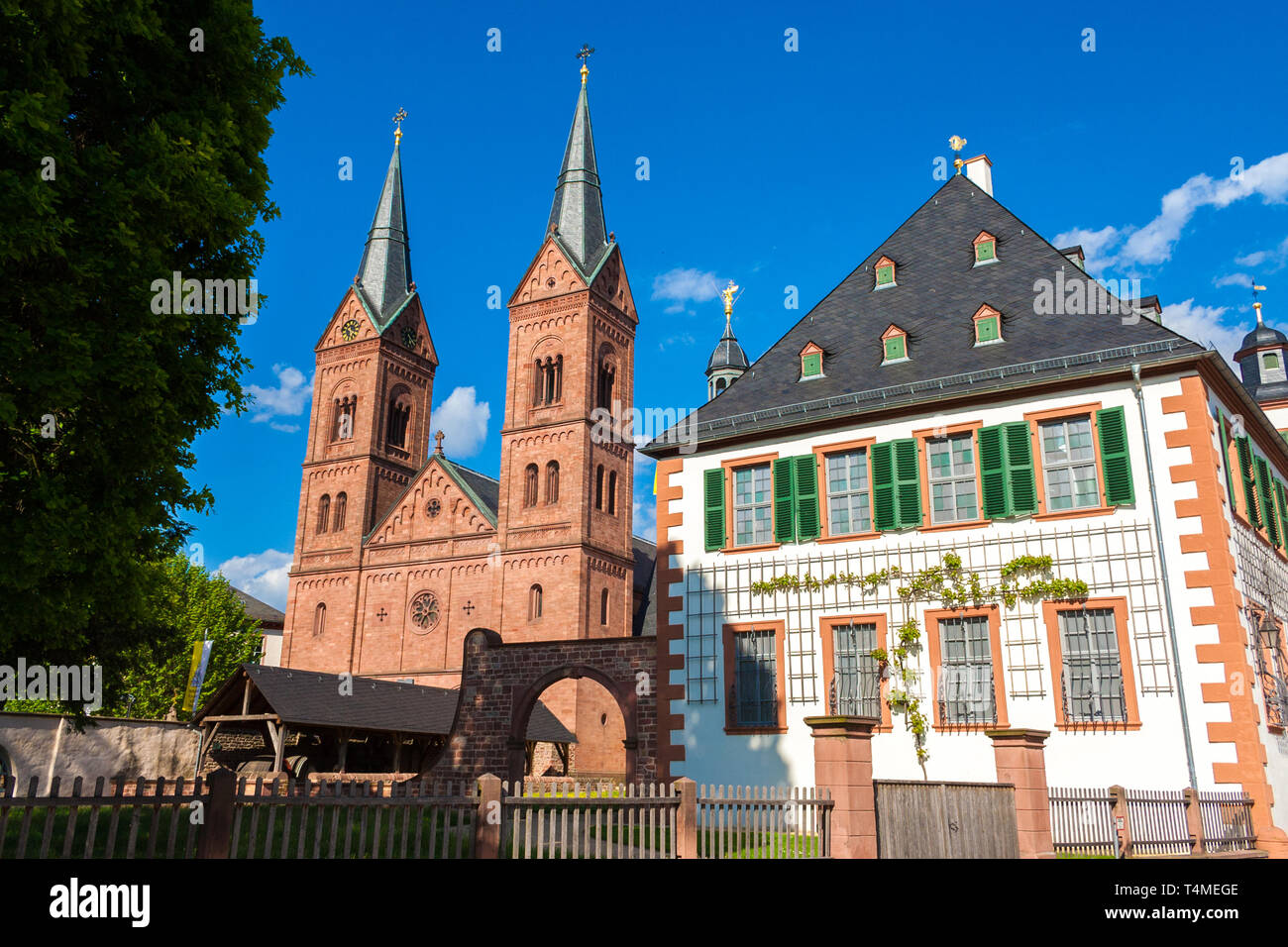 Seligenstadt's famous landmark, the Einhard-Basilika (Basilika St. Marcellinus & Petrus) with its two Romanesque Revival towers next to the former... - Stock Image