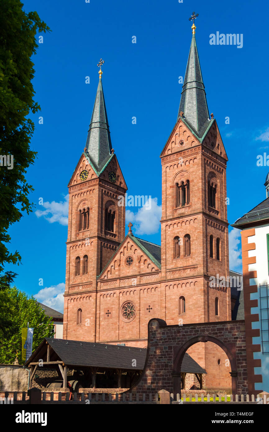 Perfect portrait view of the two Romanesque Revival towers at the west façade of the historic Basilika St. Marcellinus und Petrus, also known as... - Stock Image