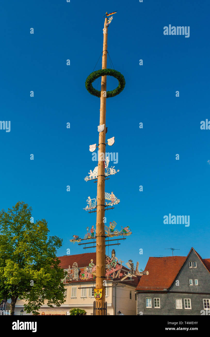 Nice view of the top part of the maypole (Maibaum) on the marketplace in Seligenstadt, Germany. From Germanic paganism and early medieval cultures,... - Stock Image