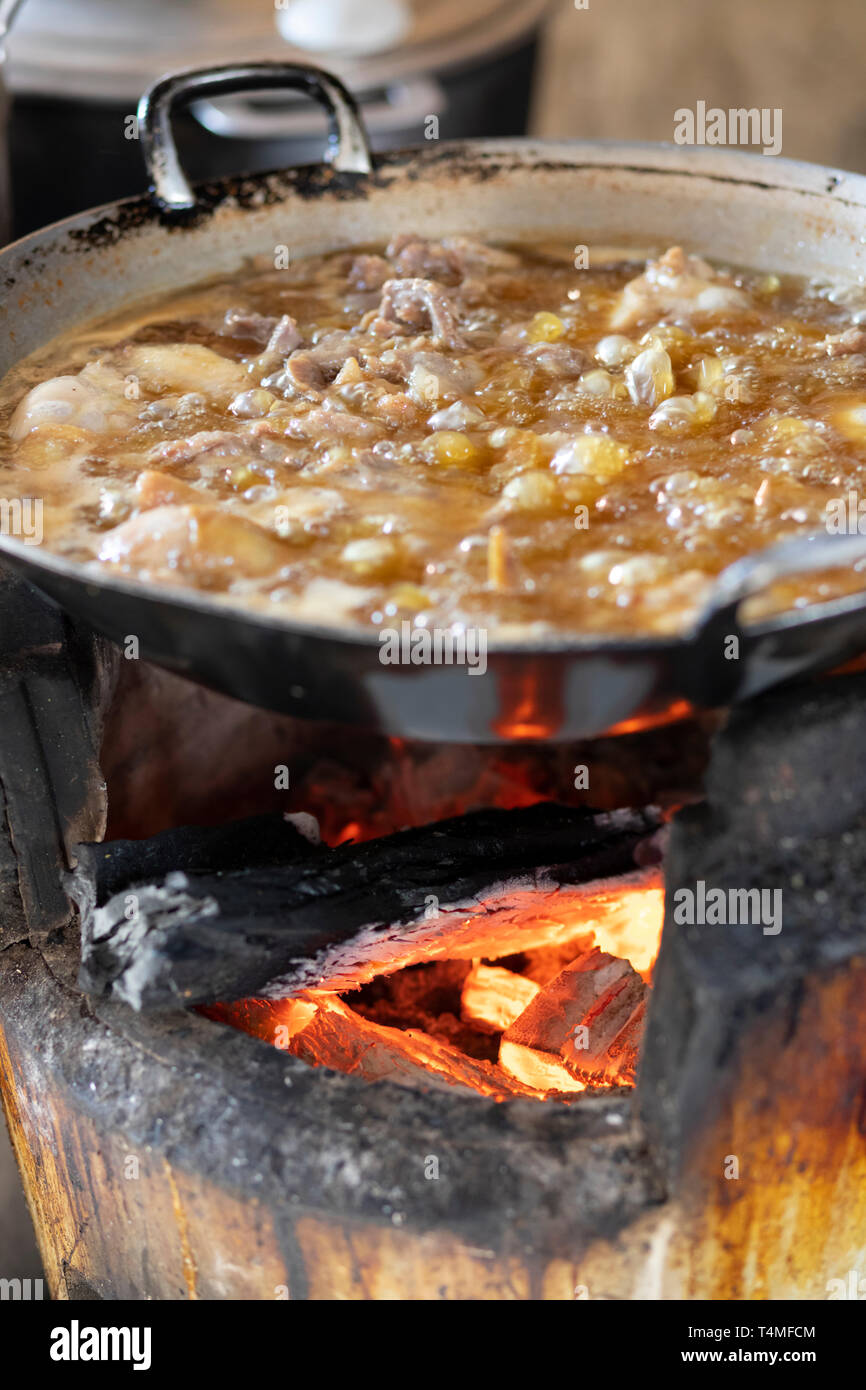 Street food simmering in wok, Phnom Penh, Cambodia, Southeast Asia, Asia - Stock Image