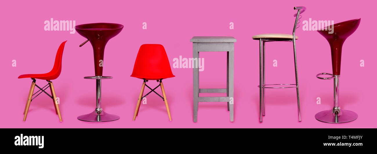 A small selection of several different chairs for the home, office or bar on a light pink background Stock Photo