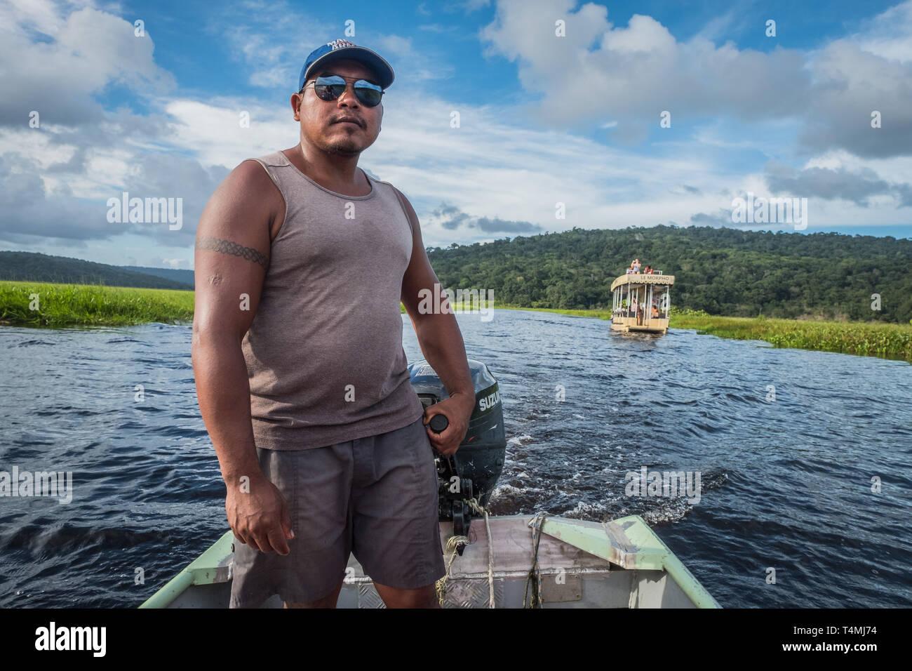 Man in a canoe, Guyana, Kaw, France - Stock Image