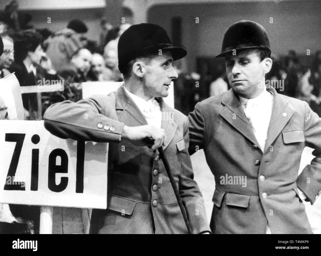 The german equestrians Fritz Thiedemann (L) and Magnus von Buchwaldt during the Frankfurt Equestrian Tournament in the Festhalle in Frankfurt am Main on 25.03.1956. | usage worldwide Stock Photo