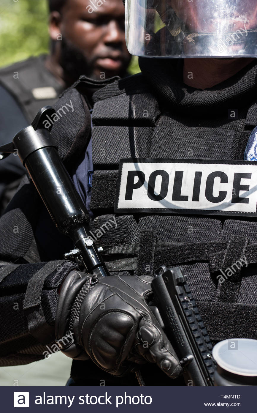Police in Riot Gear with Teargas to disperse crowd at KKK rally - Stock Image