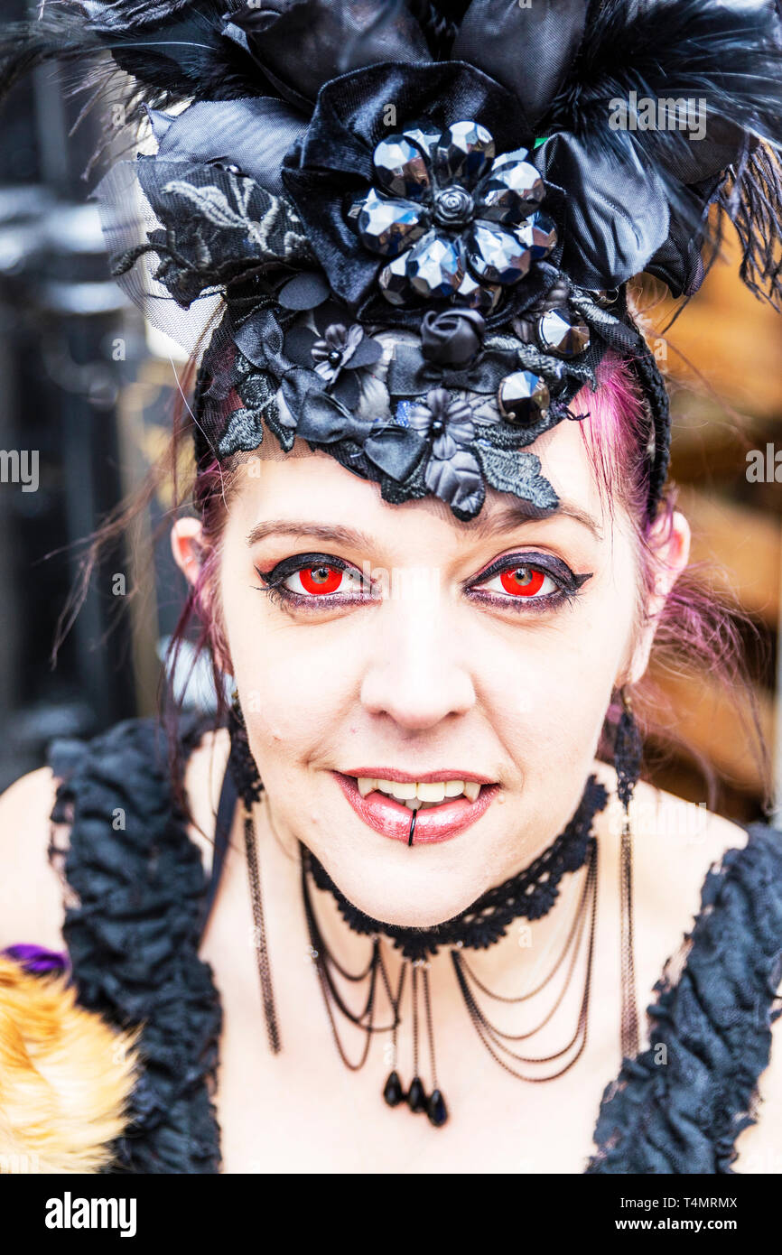 Whitby Goth Weekend 2019, Whitby Goths, Whitby Goth, goth, goths, gothic costume, Whitby, Yorkshire, UK, Goth characters, goth costume, Red eyes Stock Photo