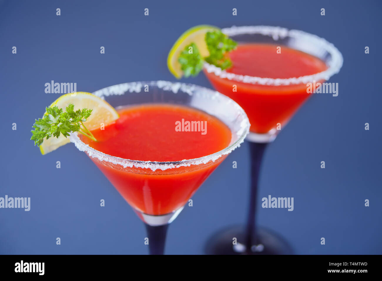 Bloody Mary Cocktail In Glasses With Lime Tomato Bloody Mary Spicy Drink On Blue Background Stock Photo Alamy