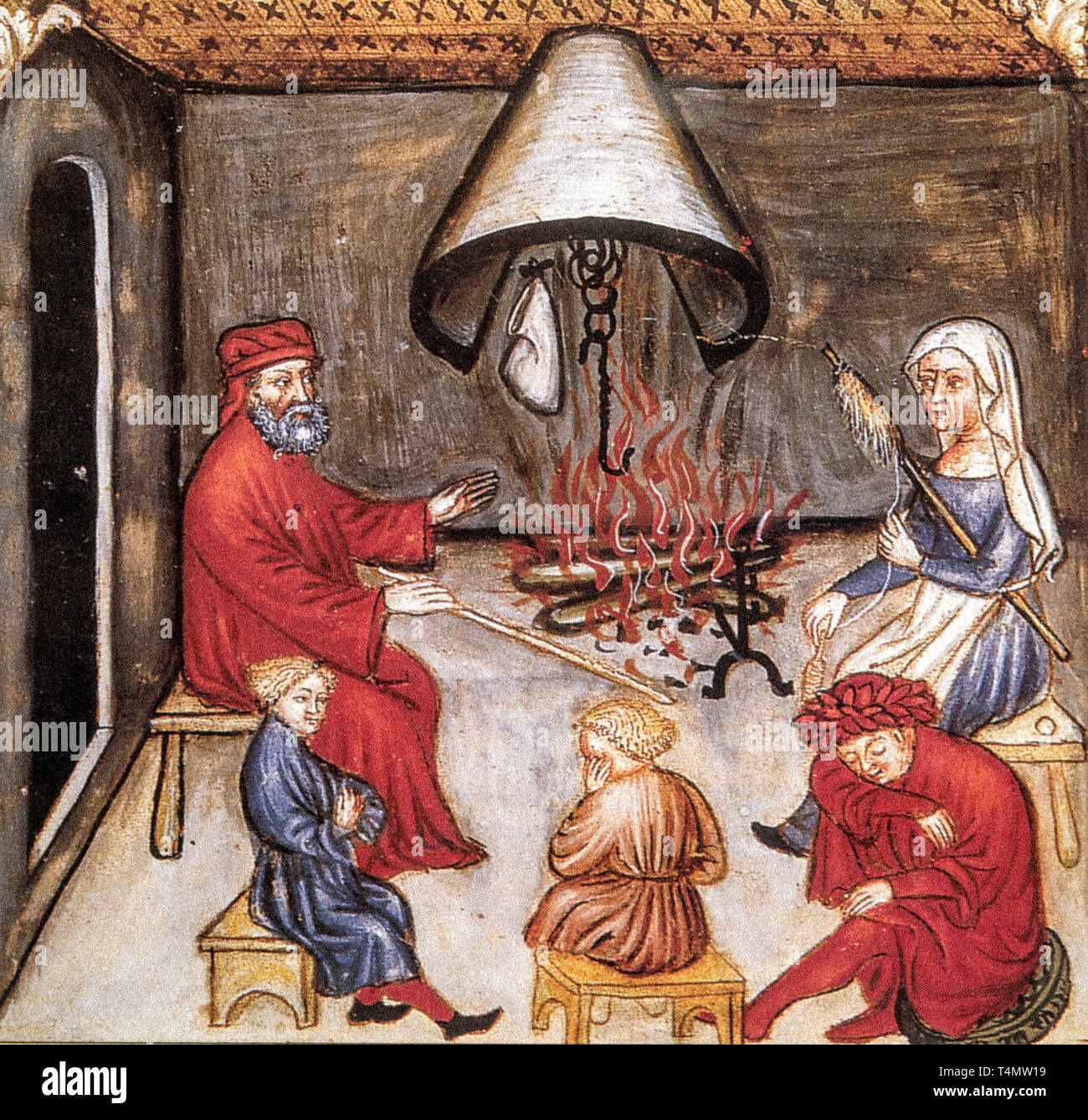 Confabuator - In the Middle Ages the Confabuator was the person who told stories. In this scene the lady spins the wool while listening, two of the boys are about to fall asleep, while one mimics the scenes of the story - Stock Image