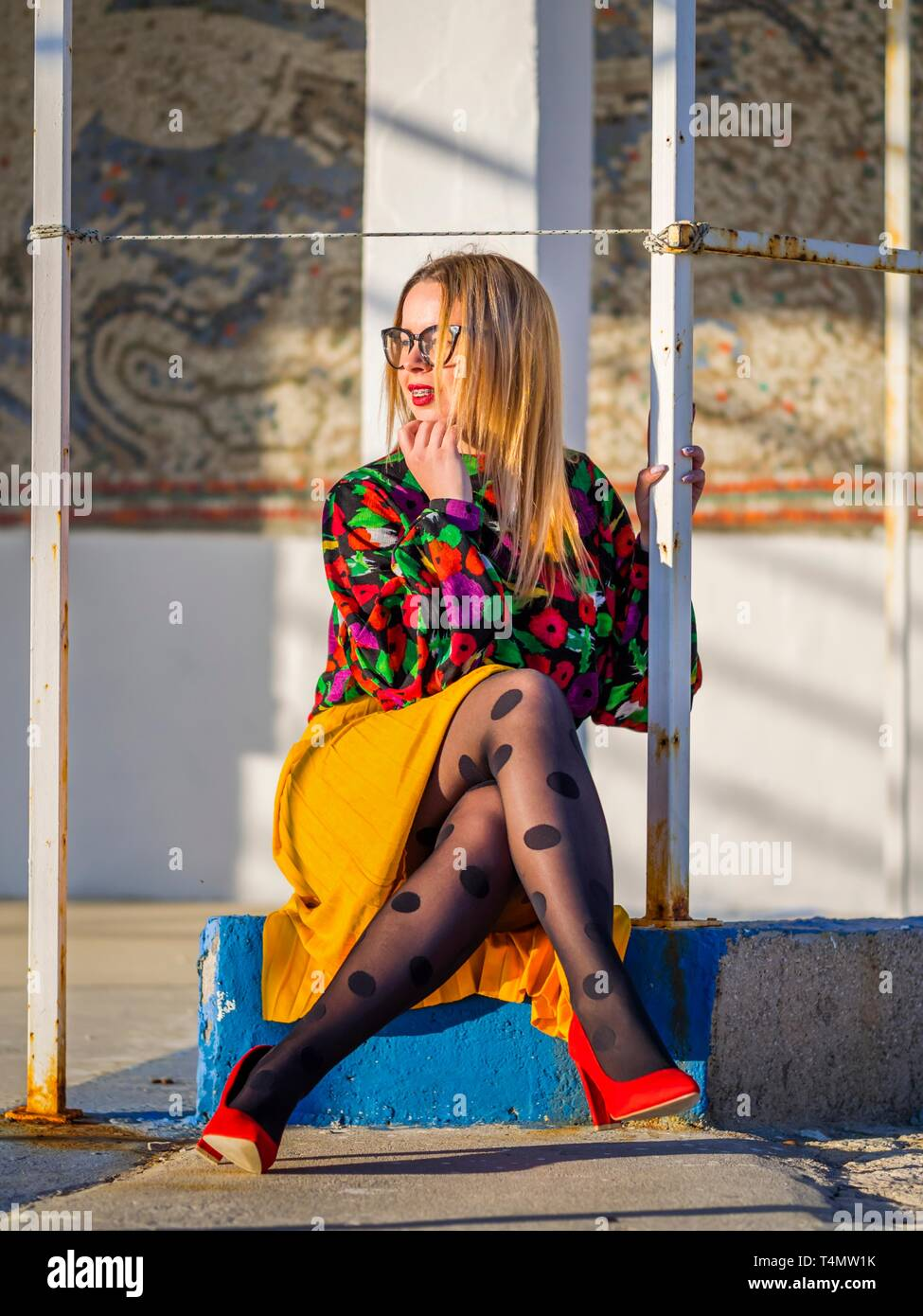 Young woman legs heels enjoying sun - Stock Image