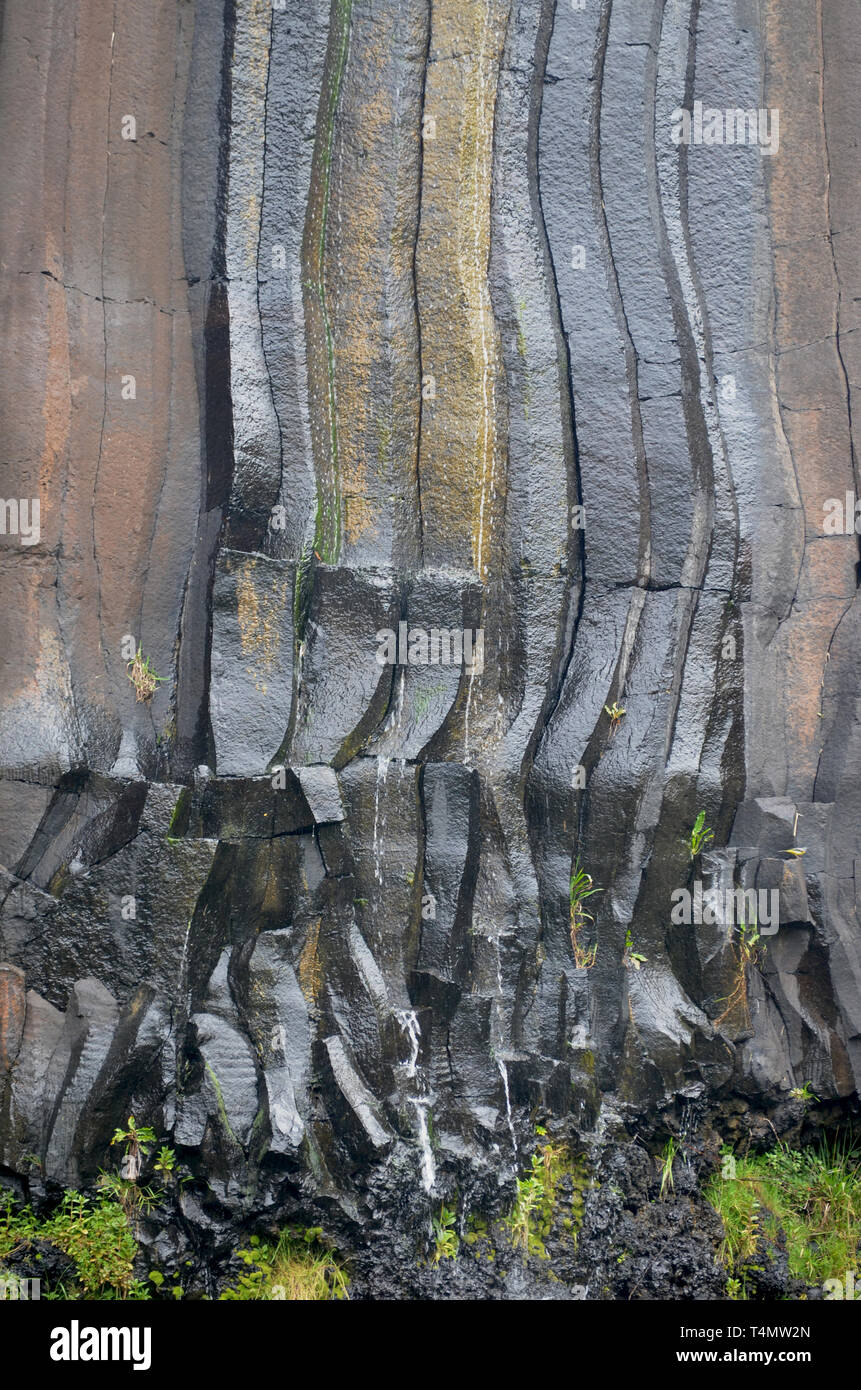 Basaltic columns in Santa Maria island, Azores: an outstanding natural area now threatened by the installation of a satellite-launching spaceport - Stock Image