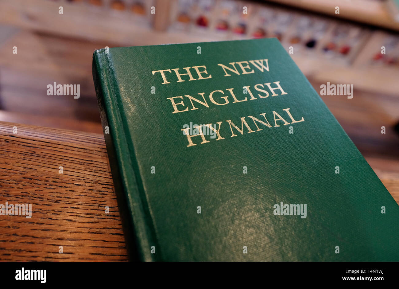 the new english hymnal hymn book on church pew, norfolk, england - Stock Image