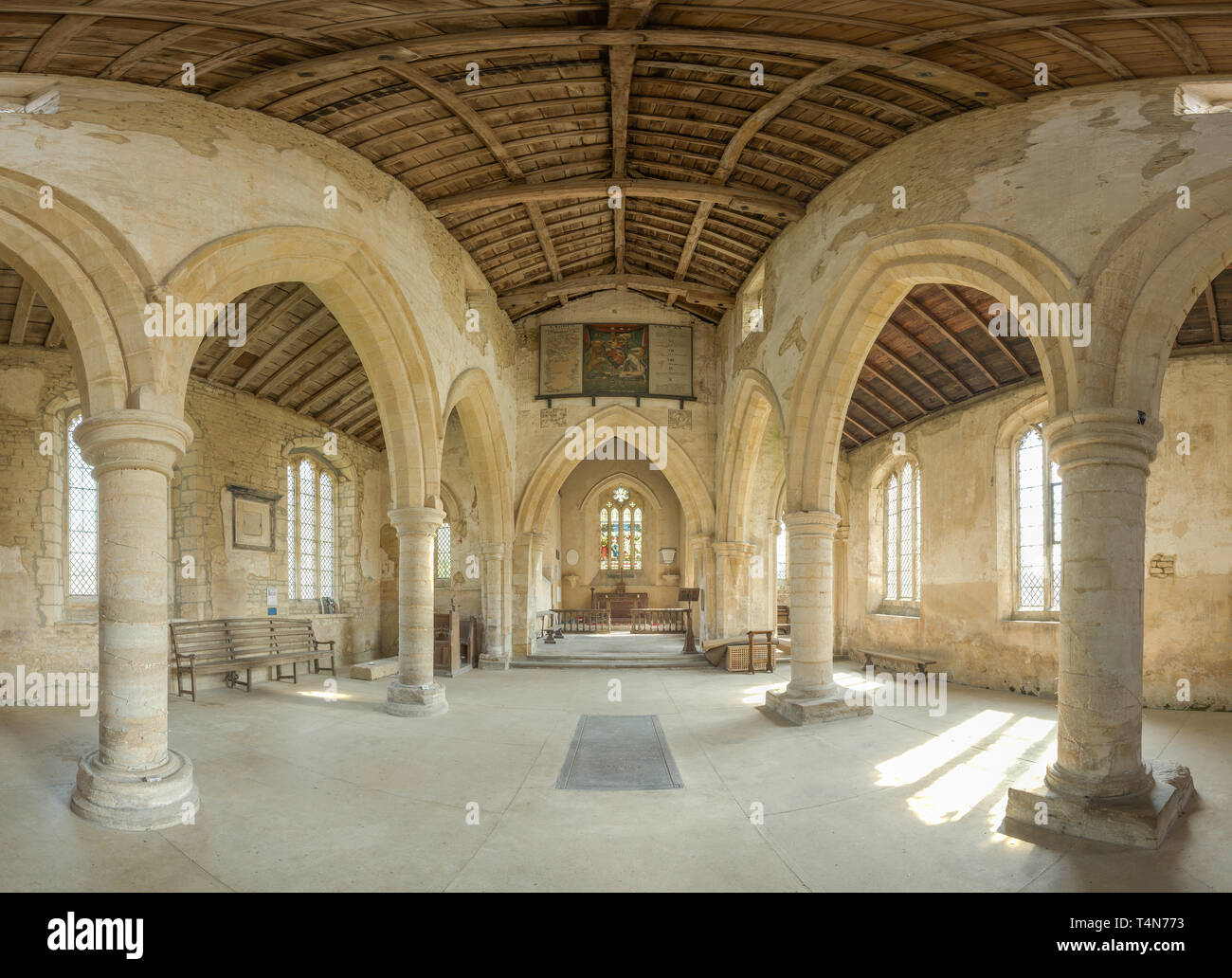 Started in the thirteenth century, the village medieval church at Aldwincle, now redundant and bare, was where the poet John Dryden was baptised. - Stock Image