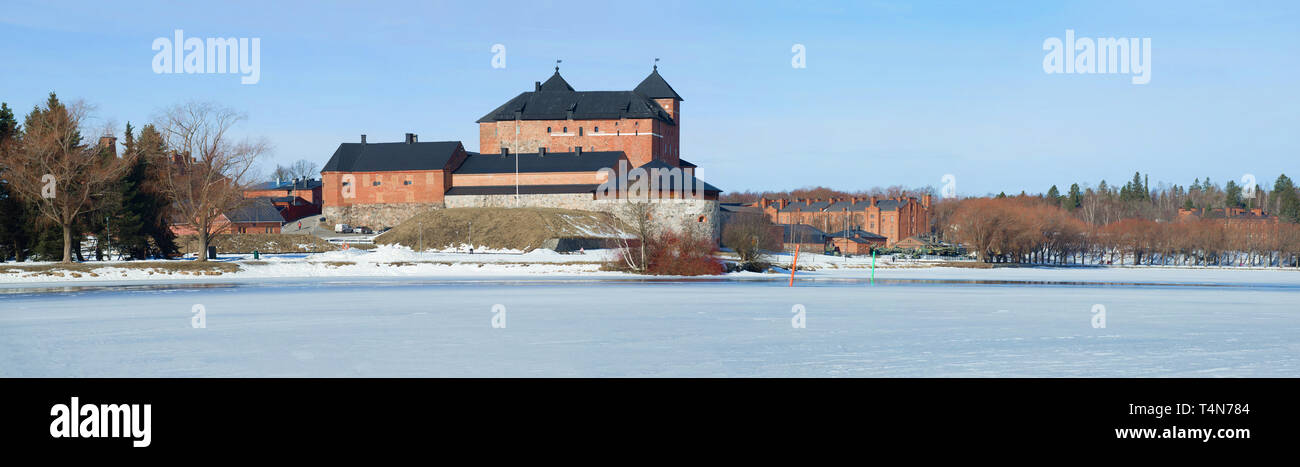 Panorama of lake Vanajavesi with its old fortress on a sunny March day. Hameenlinna, Finland Stock Photo